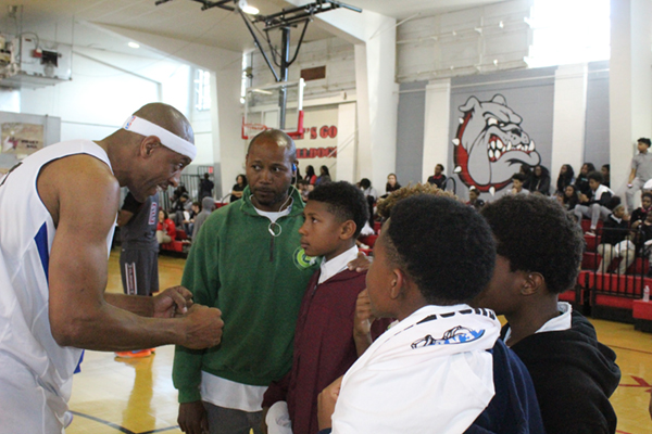 Jerome Williams inspiring young athletes with captivating speech.