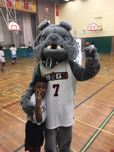 Big3 Mascot posing with young participant